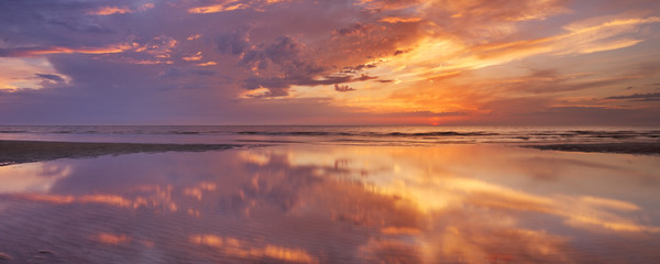 Sunset reflections on the beach, Texel island, The Netherlands
