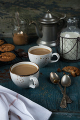 Coffee with milk and homemade oatmeal cookies