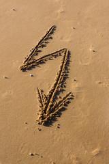 Arrow dawn drawn in the sand
