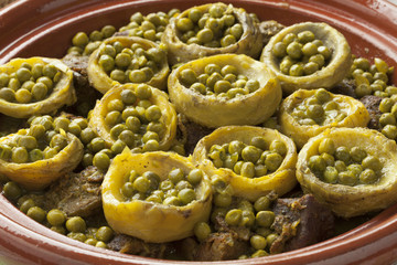 Wall Mural - Tagine with meat, artichoke hearts and green peas
