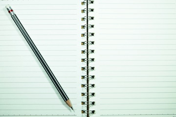 Paper notebook and a blackpencil