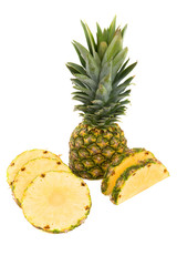 Pineapple with slices on a white background