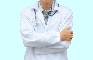 Doctor with stethoscope standing with arms crossed isolated on blue