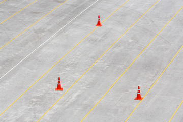 Concrete parking lot with traffic cones