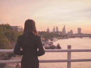Businesswoman admiring sunrise in London