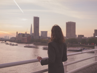 Businesswoman admiring sunrise in London