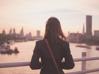 Young woman admiring London at sunrise