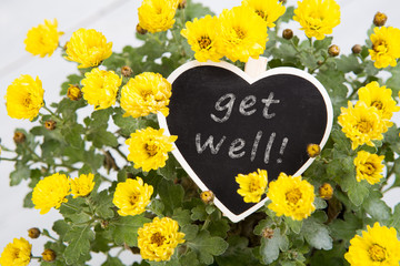 Get well - bouquet of flowers with a heart message card