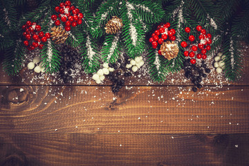 Beautiful Christmas wooden background with snow fir tree. View with copy space