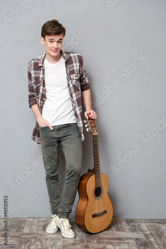 Young Man Standing With Guitar