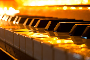 The keyboard of the piano in the golden light