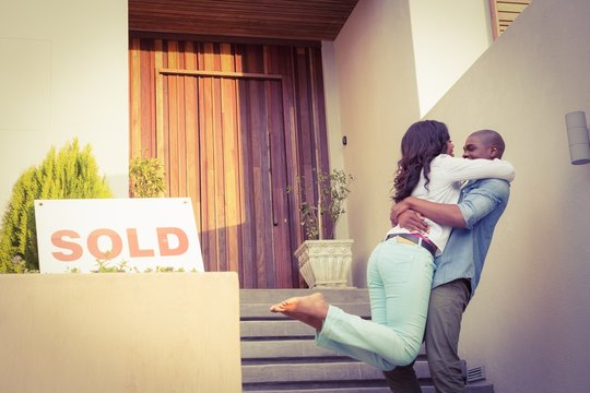 Happy african american couple after buying new house