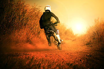 Poster Motorise man riding motorcycle in motorcross track use for people activit