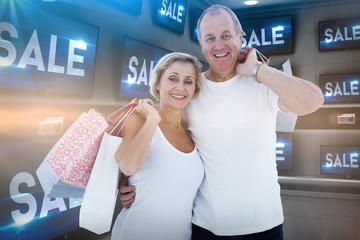 Composite image of couple with shopping bags