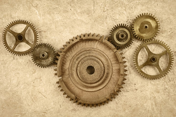 Connected gear wheels on a vintage background