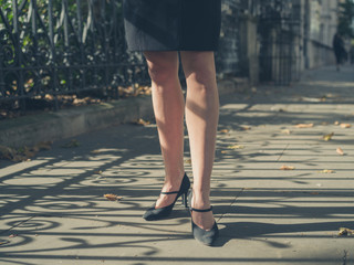 Legs of young businesswoman in the park