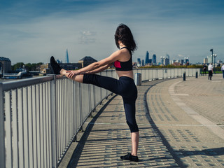Fit young woman working out in the city