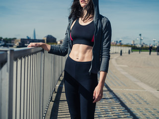 Fit and athletic young woman in city