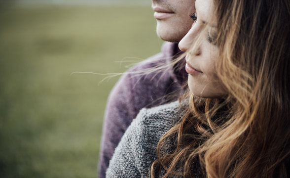 Young loving couple sitting on the grass