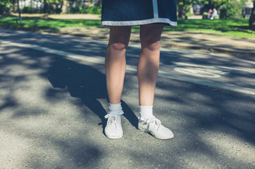 Legs of young woman in park