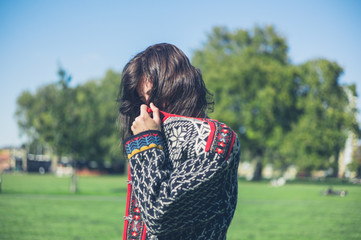 Woman wearing knitted jumper in the park
