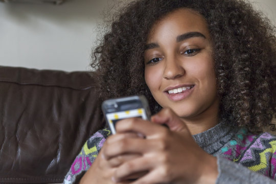 Mixed Race African American Girl Teenager Texting Cell Phone