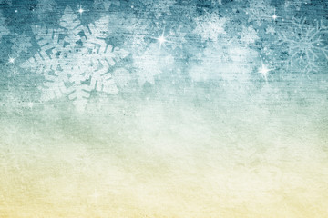 Grunge abstract blurry snowflake shapes and sparkle illustration on textured golden blue copy space background. Dreamy winter snowfall greeting card background.