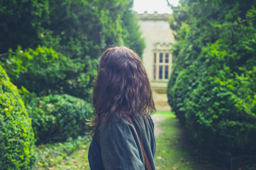 Young woman exploring formal garden