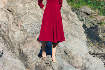 Woman in red walking on rocks