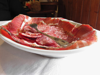 Platter of cold cuts with rustic ham prosciutto and salami from Tuscany, Italy