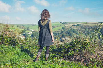 Woman admiring countryside from hill