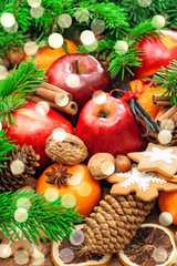 Christmas food background. Apples, cookies, spices, lights