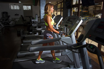Girl Running on treadmill in the gym