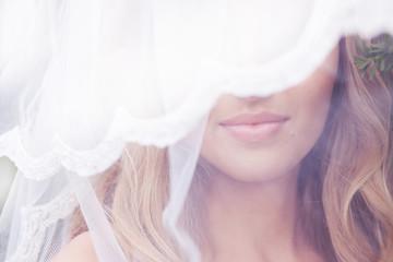 Close up portrait of a beautiful bride in veil
