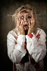 Shock horror. Surprised businesswoman zombie