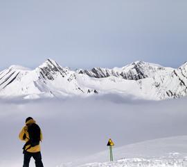 Freerider on off-piste slope in mist