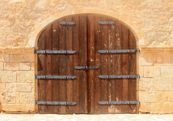 Old weathered brown wooden vintage gate