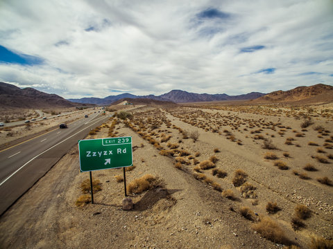 Zzyzx Road freeway sign along the Interstate 15 freeway near Baker