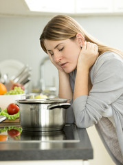 sad woman leaning on table at kitchen