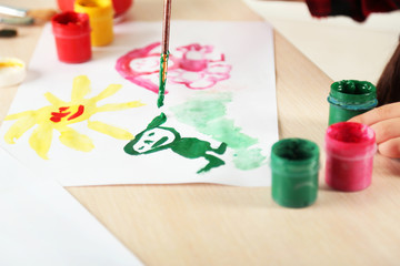 Cute little girl painting picture, close-up