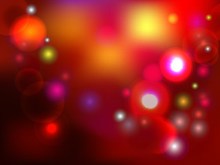 Colorful holiday background with lights and spackles