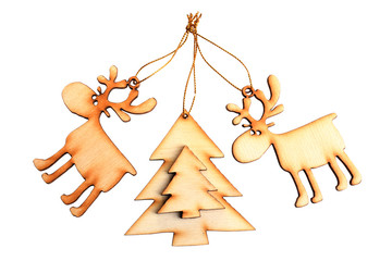 wooden tree decorations in the shape of reindeer and Christmas trees on a white background isolated