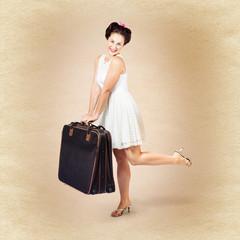 Vintage travel female holding old fashion suitcase