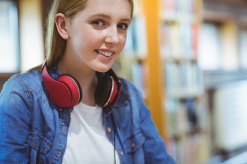 Smiling student with headphones looking at the camera