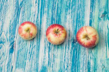 apples on  wood background. toning.