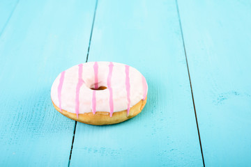 White And Pink Donut On Blue Background
