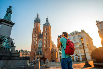 Autocollant pour porte Cracovie Tourist photographing in the center of Krakow