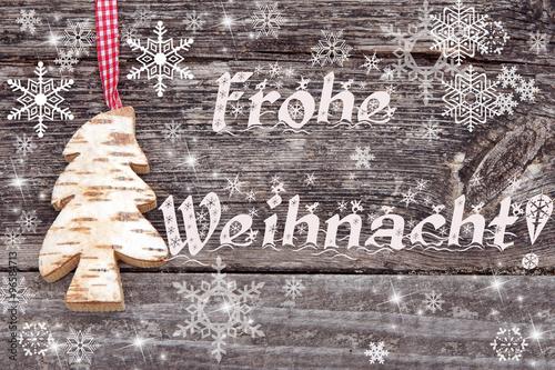 frohe weihnacht schrift auf holz mit tannenbaum und. Black Bedroom Furniture Sets. Home Design Ideas