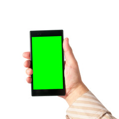 Man holds in hand tablet PC in portrait mode with green screen isolated on white. Chroma key screen for placement of your own content.