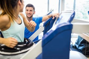 Woman using an anti gravity treadmill beside trainer